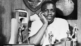 Jackie Robinson at Home With his Various Trophies