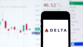In this photo illustration a Delta Air Lines logo seen...