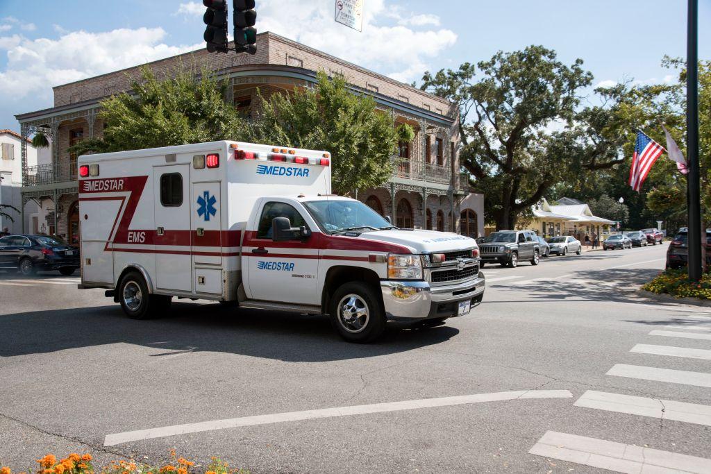 Alabama USA, An ambulance on an emergency call trailing through the town center