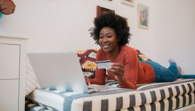 Attractive African American woman checking her bank account online