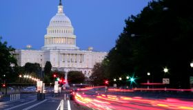 US Capitol Building and traffic tail lights on Pennsylvania Avenue.