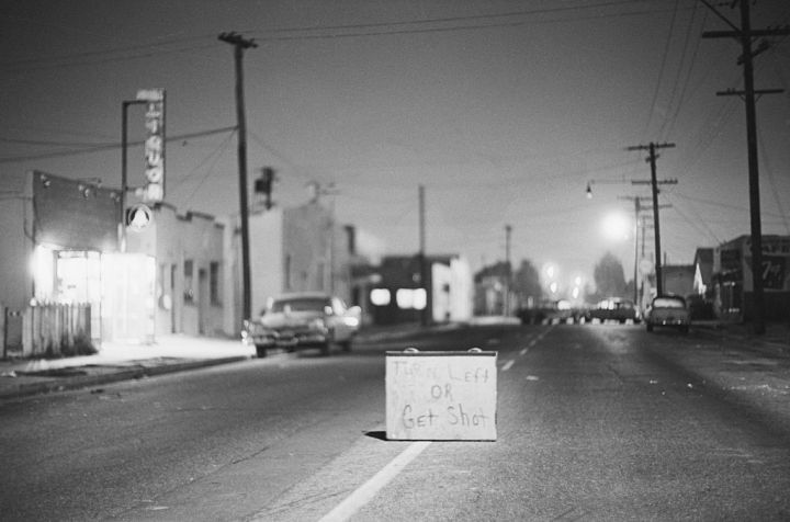 """""""Turn Left Or Get Shot"""" Sign In Street"""