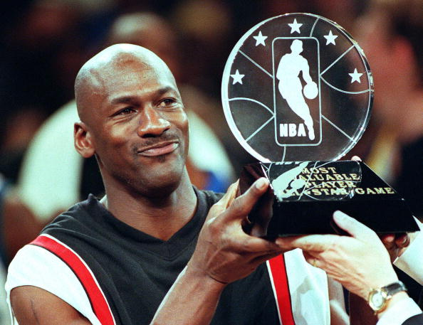 Chicago Bulls' Michael Jordan holds up the Most Va