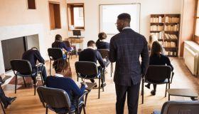 Teacher supervising the class during a school exam