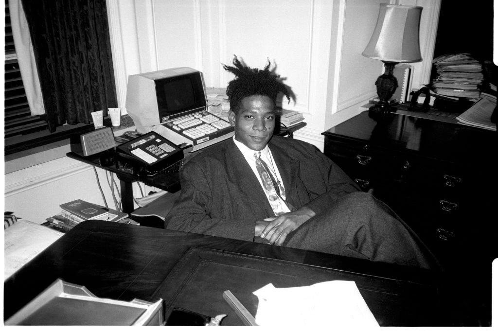 Jean - Michel Basquiat at the surprise birthday party for Susanne Bartsch at the Rainbow Roof, at Steven Greenberg's office, 30 Rockefeller Plaza
