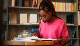 Black student having a study session at a cafe table