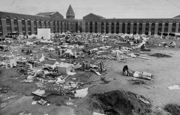 Mattresses, crates and rubble fill the yard after riots at A