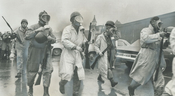 Saving in to crush riot; National Guardsmen wearing gas masks prepare to storm Cellblock D; the stro...
