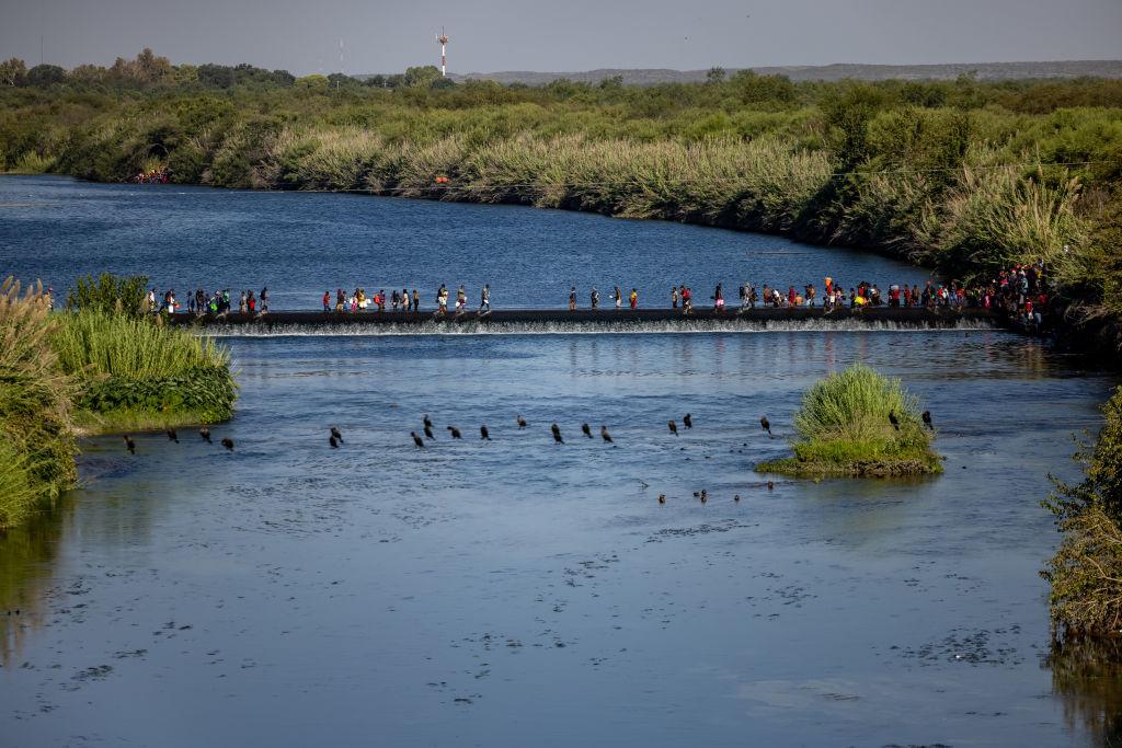Large Migration Surge Crosses Rio Grande Into Del Rio, Texas