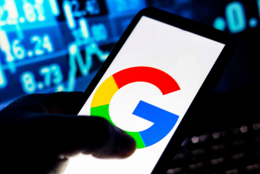 In this photo illustration the Google logo seen displayed on...