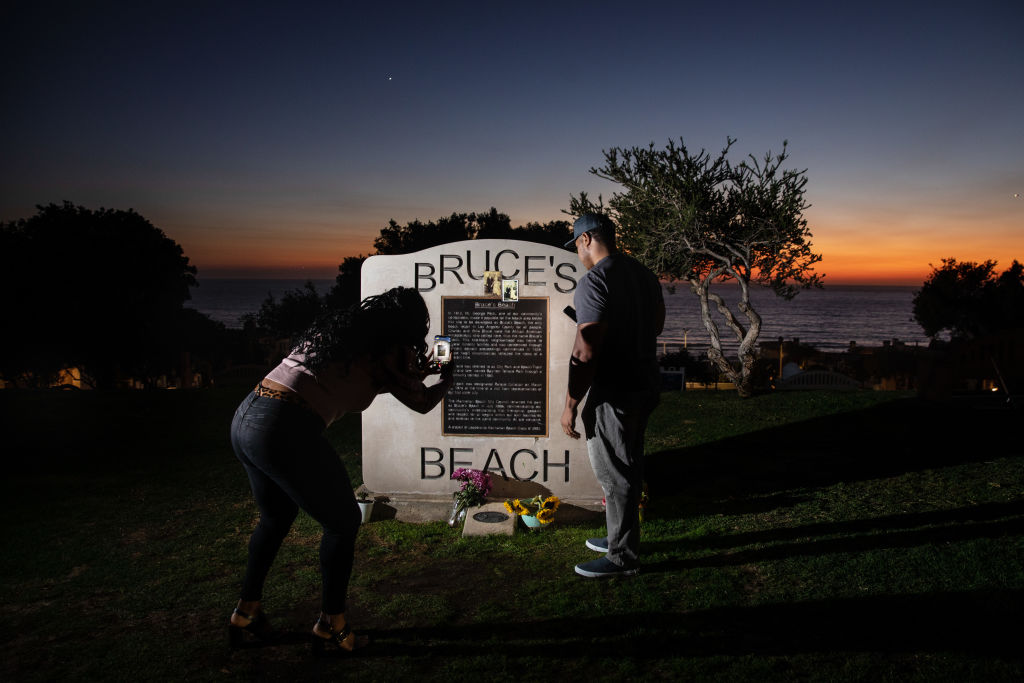 California Gov. Gavin Newsom signs SB 796 authorizing the return of beach-front land to the Bruce family, in Manhattan Beach, CA