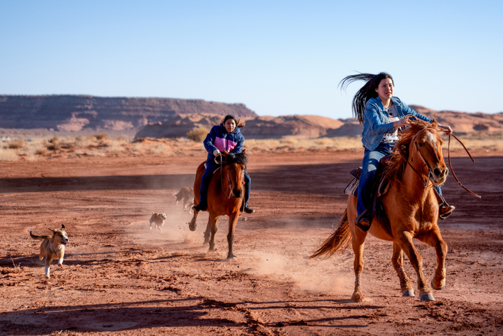 Young Navajo Siblings Riding Their Horses