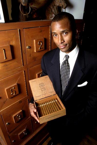 Granville Adams holds a box of pre-embargo 1962 Cuban Dunhil